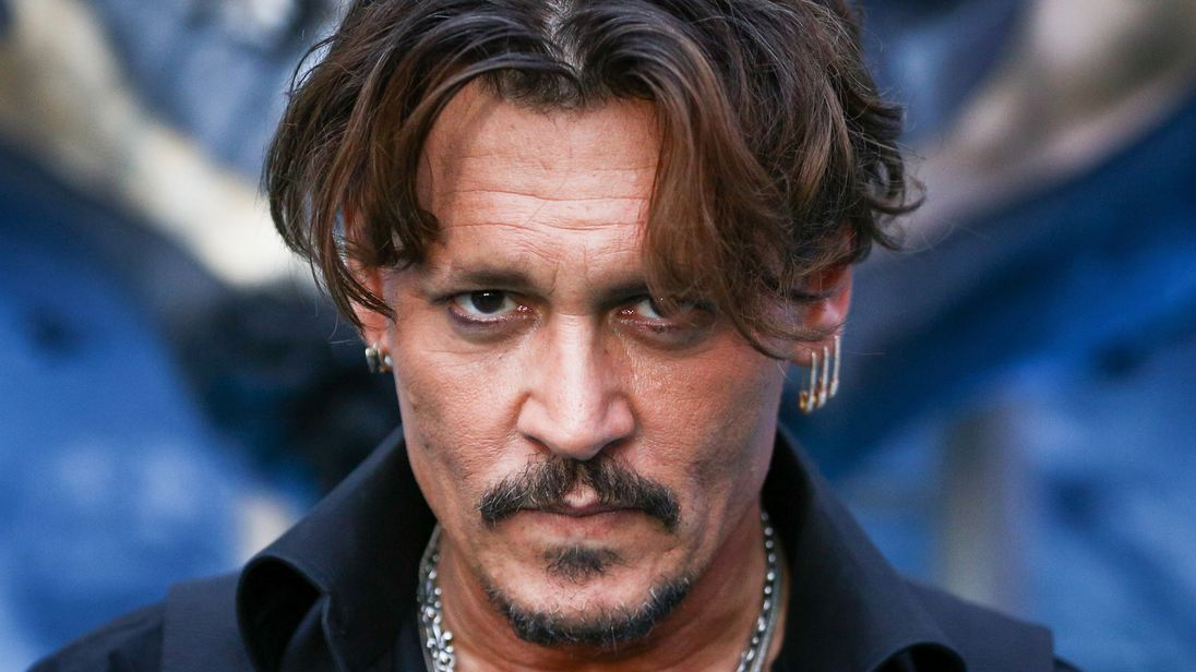 johnny depp sued for punching crew member twice in the ribs