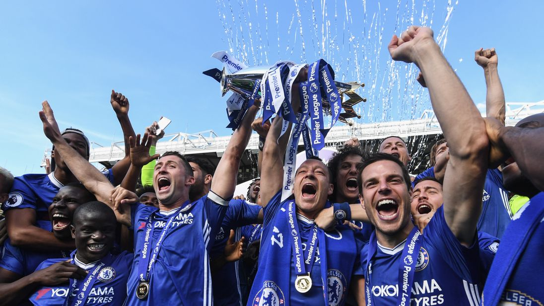 A jubilant Chelsea celebrate with the Premier League Trophy