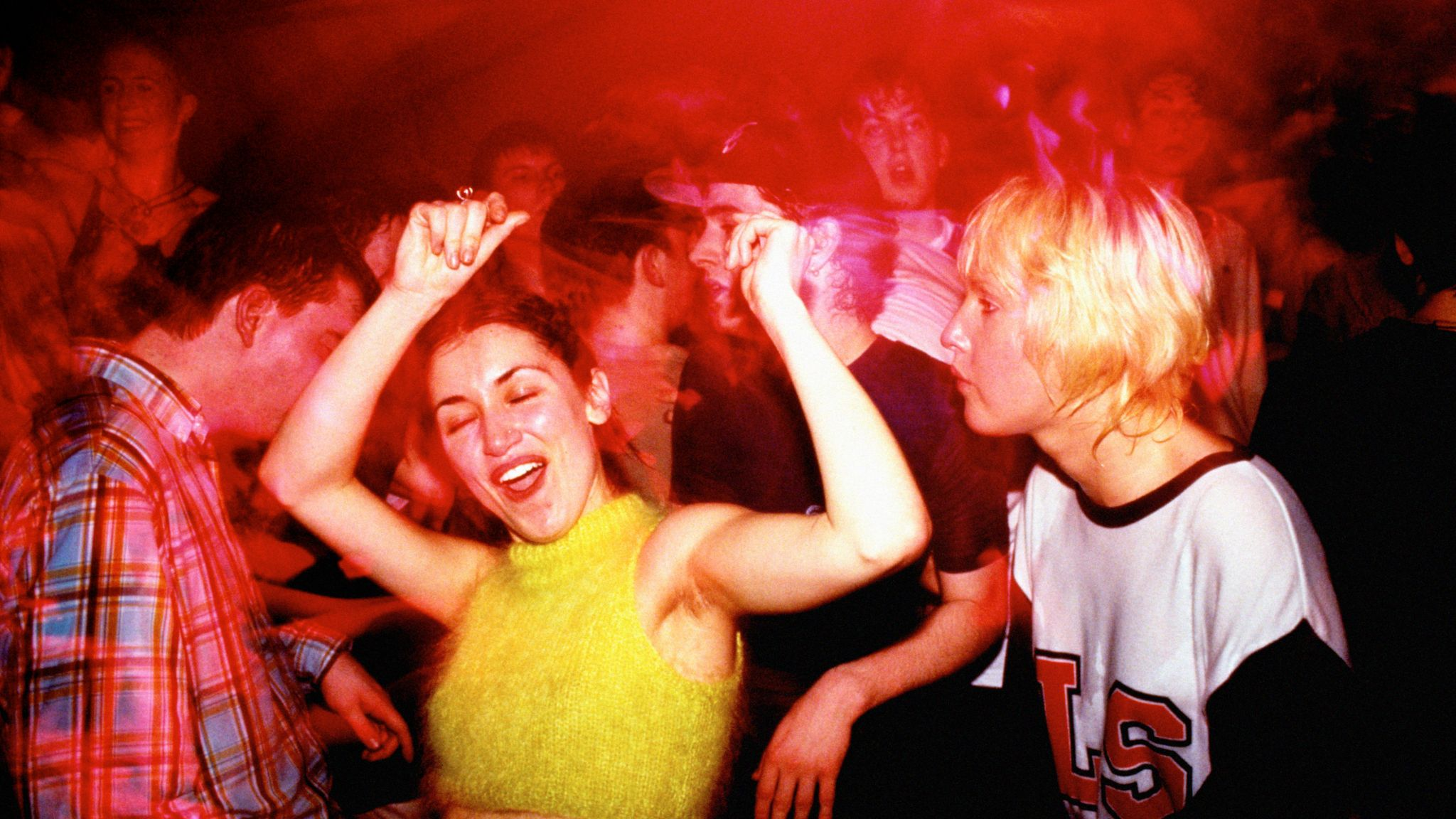 Ravers dancing in the mid 1990s