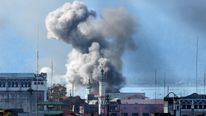 An explosion is seen after a Philippines army aircraft released a bomb during an airstrike