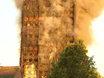 Apartment block on fire in West London in the day light.