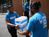 Charity workers deliver water for Grenfell Tower residents
