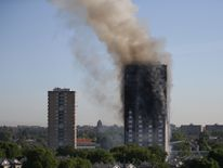 Smoke billows from Grenfell Tower as firefighters attempt to control a huge blaze