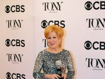 """Bette Midler poses with her award for Best Performance by an Actress in a Leading Role in a Musical for """"Hello, Dolly!"""""""