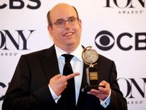 """Christopher Ashley poses with his award for Best Direction of a Musical for """"Come From Away."""""""