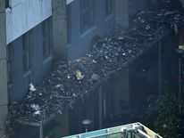 Debris on a roof after a huge fire engulfed the 24 story Grenfell Tower in Latimer Road, West London