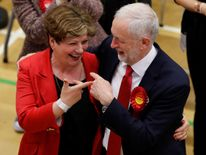 Labour's Jeremy Corbyn and Emily Thornberry share a joke as he arrives at the country in Islington