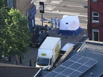 Forensic teams examine the scene where a van ploughed into pedestrians in Finsbury Park