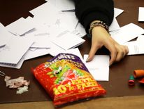 A worker at the count in Hastings relies on a bag of sweets to keep them going into the early hours