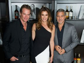 Rande Gerber, Cindy Crawford and George Clooney attend the Casamingos Tequila & Cindy Crawford book launch party at The Beaumont Hotel on October 1, 2015 in London, England