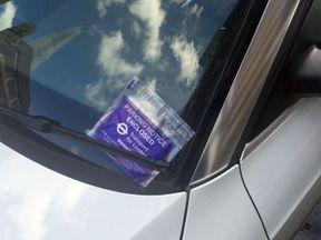 A parking ticket left on a car near London Bridge