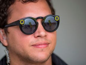 A Snap Inc employee wears its Spectacles in Venice, Los Angeles, during a protest at one of its stores
