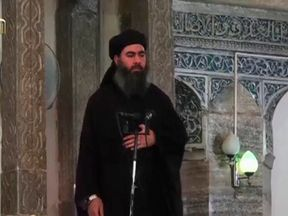 Baghdadi pictured at his first public appearance at a mosque in Mosul