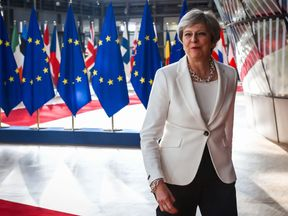 Theresa May arrives on the second day of an EU summit in Brussels