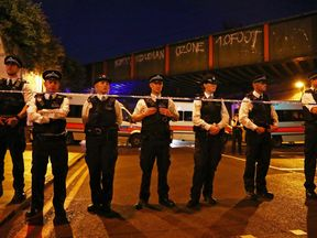 Police guard the scene after a terror attack in Finsbury Park