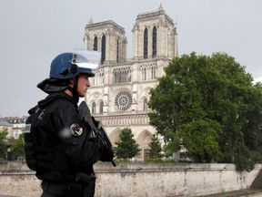 A police officer stands guard following the Notre Dame hammer attack