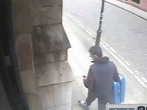 This image shows Abedi with the blue suitcase police want to locate