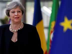 Theresa May arrives at the EU summit in Brussels
