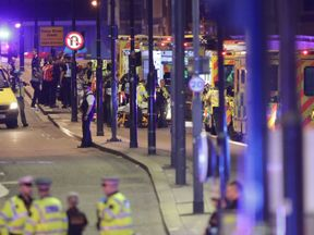 Emergency personnel tend to wounded on London Bridge. Pic: Yui Mok/PA Wire