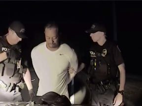 Dashcam footage shows Tiger Woods being arrested