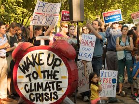 Protesters outside the White House on the day Donald Trump withdrew US from Paris climate deal