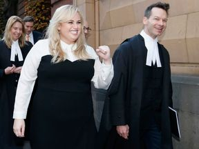 Rebel Wilson pumps her fist as she leaves the court in Melbourne