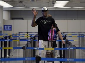 Dennis Rodman at Beijing's international airport en route to North Korea