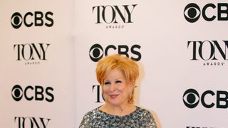 "Bette Midler poses with her award for Best Performance by an Actress in a Leading Role in a Musical for ""Hello, Dolly!"""