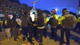Campaigners face off with police near Richmond Road in Forest Gate