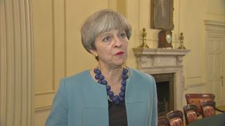 Theresa May reacts to Grenfell Tower fire in London