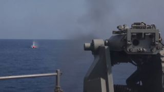 USS Bataan tests its artillery on an inflatable 'tomato'