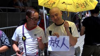 As Hong Kong celebrates the 20th anniversary of its handover from British rule, activists stage pro-democracy protests in the street