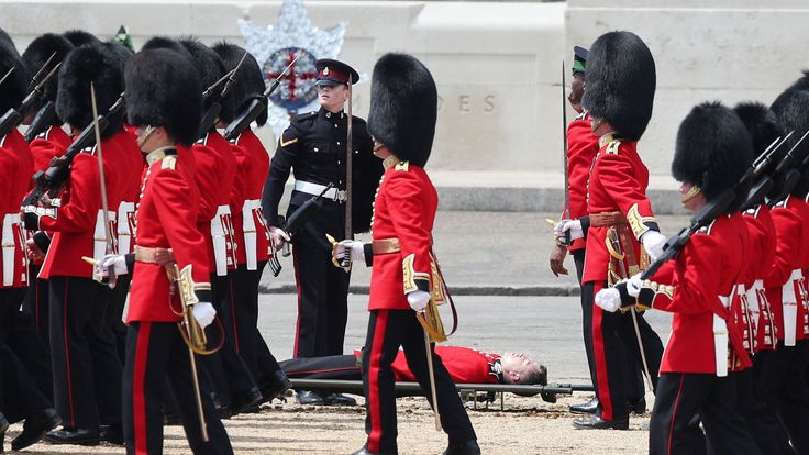 A Guardsman on a stretcher after fainting during the Trooping the Colour ceremony