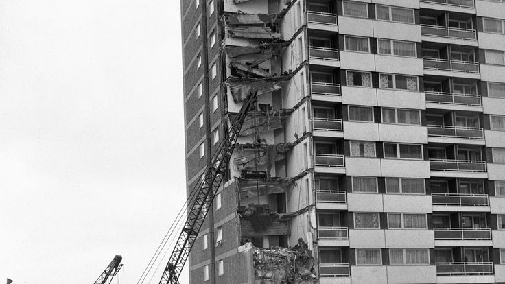 Rescue workers search debris after the collapse of a complete corner of Ronan Point, a 22 storey block of flats at Canning Town in the east End of London
