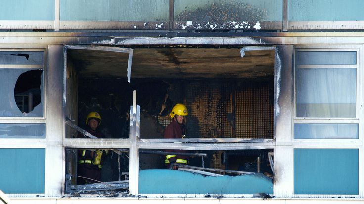 Firefighters check out a ruined flat in Lakanal House