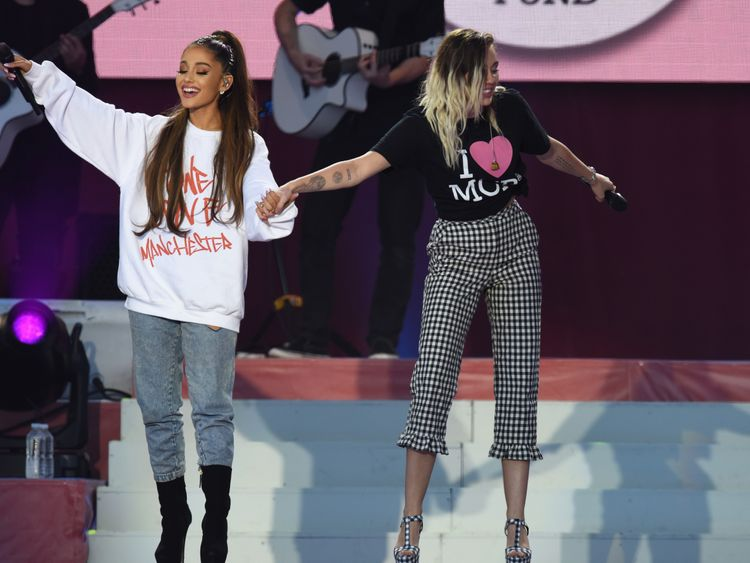 Ariana Grande on stage with Miley Cyrus at the One Love Manchester concert