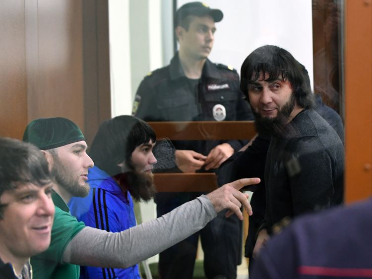 Zaur Dadayev (R) stands with his co-accused