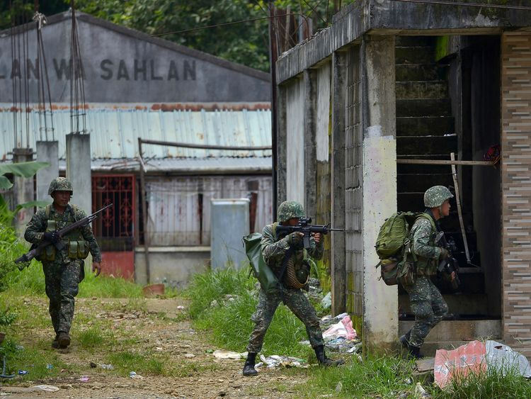Philippine marines on their way to an Islamist militants' hideout in Marawi