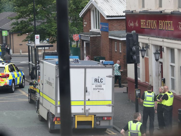 Police and a bomb disposal van at the scene