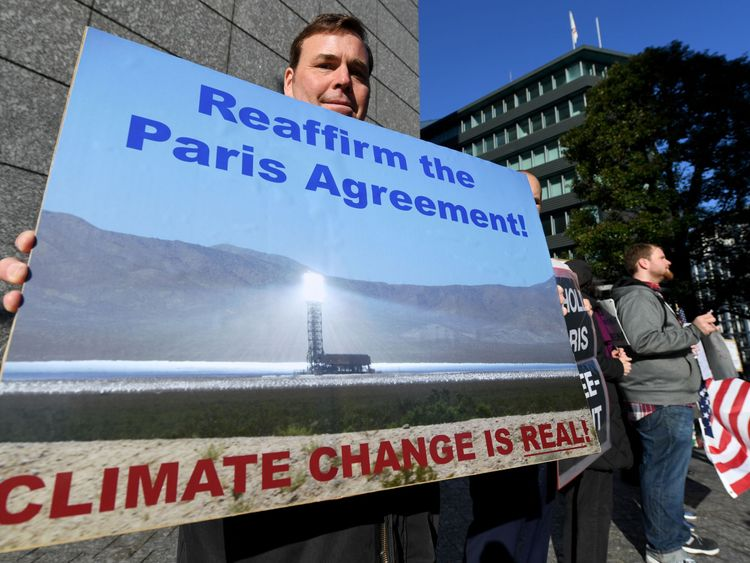 US residents living in Japan and local residents hold a rally near the US embassy in Tokyo on March 16, 2017. About 13 demonstrators demanded visiting US Secretary of State Rex Tillerson to reaffirm the US commitment to the Paris Agreement on climate change