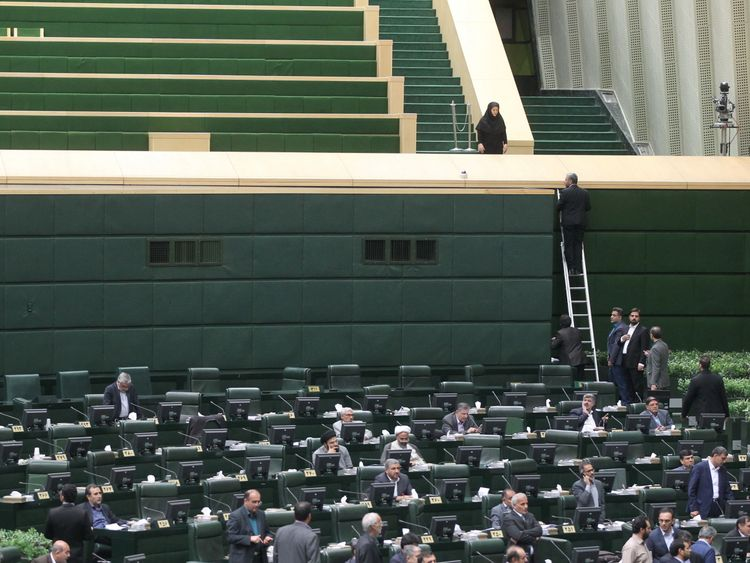 Iranian MPs attempt to continue their session amid a terror attack on their building