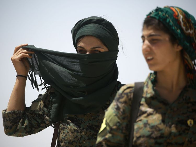Female members of the Syrian Democratic Forces stand just outside of Raqqa ahead of their advance on the city