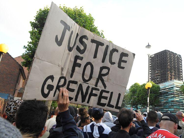 Protesters march towards The Grenfell Tower block