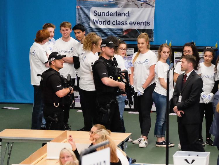 Armed police patrol the floor during the count at the Silksworth Community Pool, Tennis and Wellness Centre as the general election count begins in Sunderland