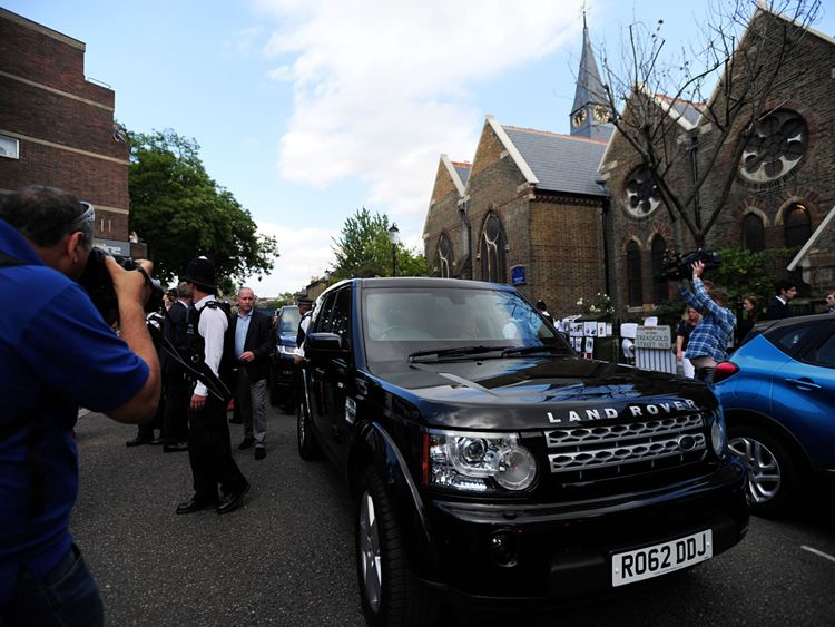 The PM leaves St Clement's Church in west London under police escort