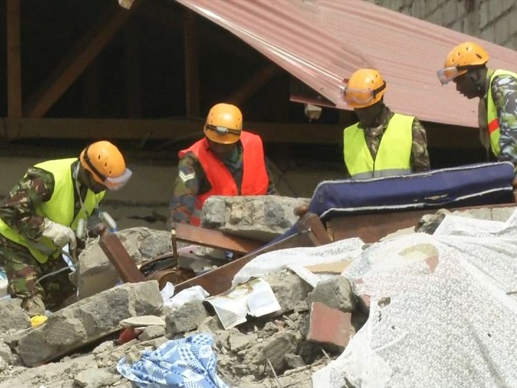 Rescue workers sift through the rubble