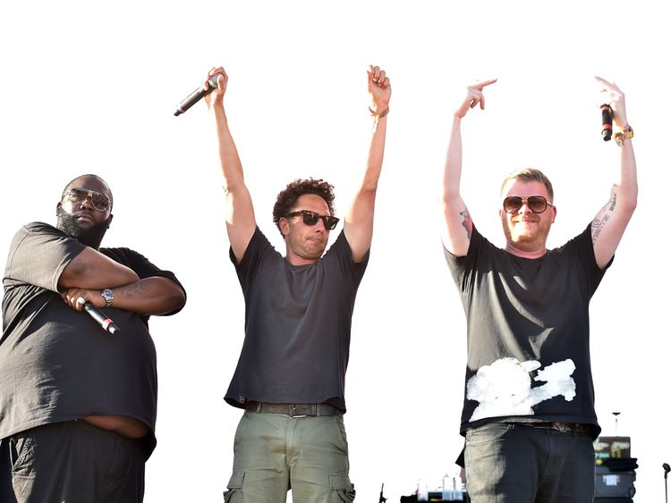 Zack de la Rocha of Rage Against the Machine (C) and Killer Mike (L) and El-P (R) of Run the Jewels perform together