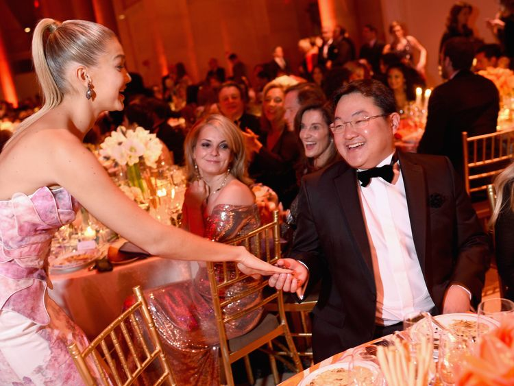 Mr Low here pictured with Victoria's Secret model Gigi Hadid