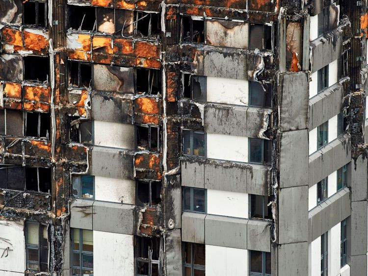 An image of burned out Grenfell Tower shows some of the cladding that had been fitted to the building