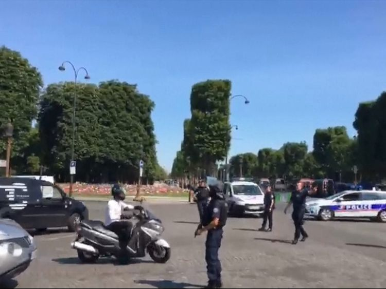 Police redirect traffic following an 'incident' involving a car on the Champs-Elysees